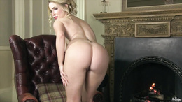 Round titted Georgie Lyall gets naked to play alone