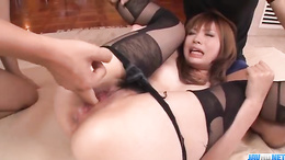 Horny redhead Mami Yuuki gets fingered and pounded hard by two dicks