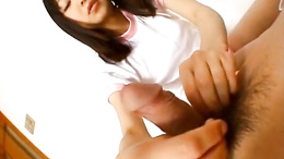 Cute girl Anna Kuramoto massages lover's dick with both hands