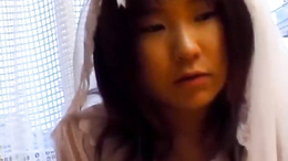 Horny bride Nami Asakura gives her hubby a hot hand and blowjob