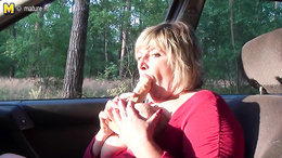 BBW granny shows her huge melons and dildo fucks herself in a car