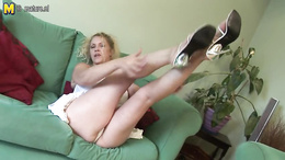Slutty mature with enormous tits spreads legs and rubs her clit