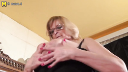 Fat granny with huge boobs gives a big dildo a blowjob and tit fuck