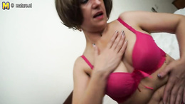Lonely granny with saggy tits strips down and reveals her cunt