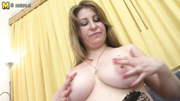 Sexy mature in sexy stockings plays with her big tits and finger fucks