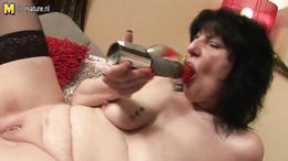 Horny granny is sucking on a shiny dildo and then masturbates