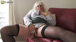 British mature BBW plays with her huge tits and pussy on the sofa