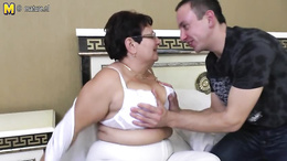 Glorious mature with glasses is fucking with a younger gentleman