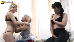 Two blondes and one black haired mature go at it in a steamy threesome