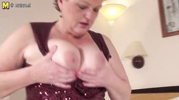 Fat mature babe strips and fucks herself hard on the bed with a toy