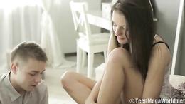 Cute brunette doll in lingerie enjoys sensual kissing her boyfriend