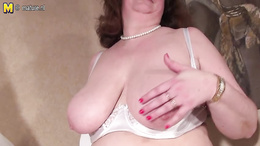 Elegant mom with huge boobs is playing with them on the camera