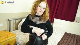 Chubby mature redhead in fishnet stockings finger fucks herself deep