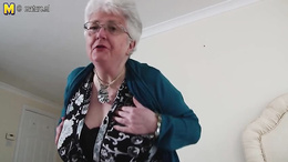 Old granny strips to show her gigantic boobs and wet pussy hole