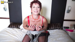 Short haired and redhead mature puts a vibrator between boobs