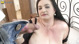 Horny mature babe with huge boobs is sucking a hard cock in POV