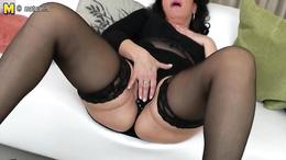 Breathtaking amateur mature in black lingerie masturbates vigorously