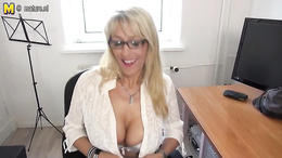 Blonde mature on high heels takes out her huge boobs and plays