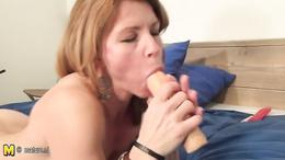 Tasty mature slut with small tits masturbates with a rubber dildo