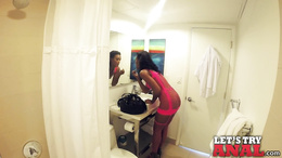Ceiling cam captures pretty black chick getting down on large cock