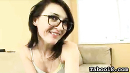 Enticing brunette slut with glasses strips down and teases on camera