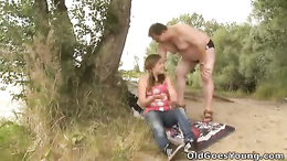 Chubby young whore with pigtails gets fucked by an old dude outdoors