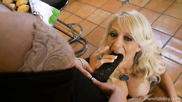Charlee Chase fucking a meaty cock in the kitchen
