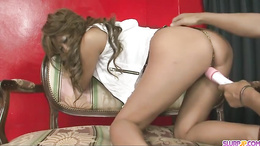 Naughty sexy Asian babe plugging pussy with a dildo