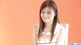 Beautiful Nao is sitting seductively on a chair during an interview