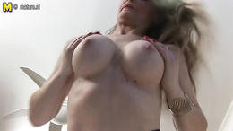 Alluring blonde babe with big boobs fingers her juicy pussy hole