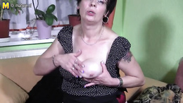 Chubby granny with glasses plays with her big boobs and sucks a toy