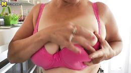 Busty blonde granny doing her cunt solo in wild masturbation scene