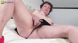 Fat granny on heels finger fucks herself vigorously on the bed