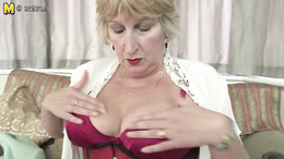 This fuckable granny gives us striptease and juicy masturbation