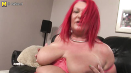 Fat redhead granny with huge boobs is fooling around with a toy