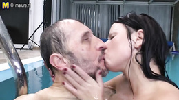 Big titted young babe sucks an old dude in the pool and fucks him