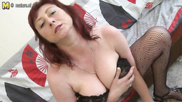 Hot mature redhead with huge saggy tits fucks herself with a dildo
