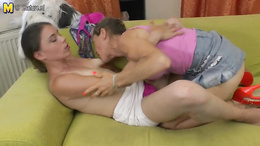 Grandma and her young lover have a hot lesbian encounter on the couch
