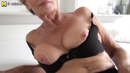 Granny puts on a hot striptease show to show off her old but firm body