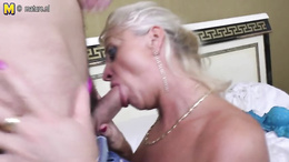 Horny granny deepthroats a young stud and gets her shaved cunt banged
