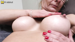 Granny with glasses and fake tits finger fucks herself vigorously