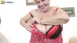 Fat grandma in fishnets gets out her huge boobs and spreads her twat