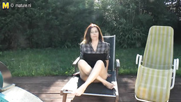 Tattooed mature gets horny and masturbates putside underneath the sun