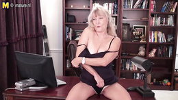 Horny granny strips naked and masturbates passionately on her desk