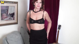 Mature office lady strips naked and plays with herself on the sofa