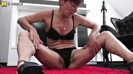 Aroused granny strips buck naked and spreads her pussy wide open
