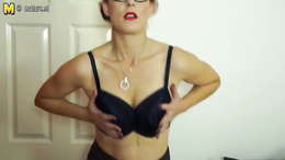 Hot milf blondie in glasses flaunting her striking hot body in a solo
