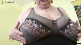 Chubby granny loves shaking her massive juggs on live cam