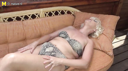 Blonde granny fingering her tight pink taco in need of an orgasm