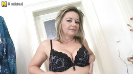 Dirty mature with fat boobs is stripping her clothes and underwear